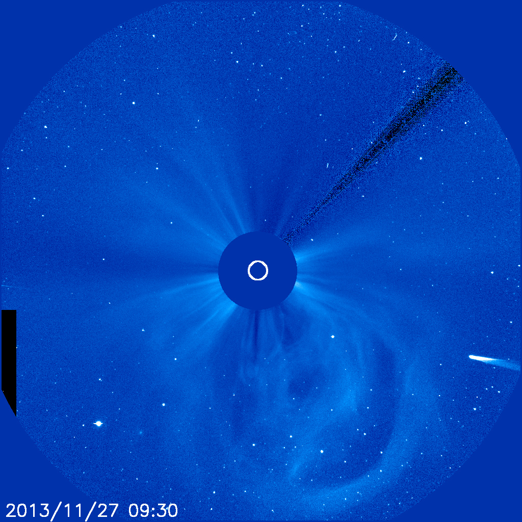 Comet ISON observed by SOHO satellites on Nov 27 2013. The sun is in the center, blocked out by the satellite image. You can also observe solar energy and wind emerging from the sun.