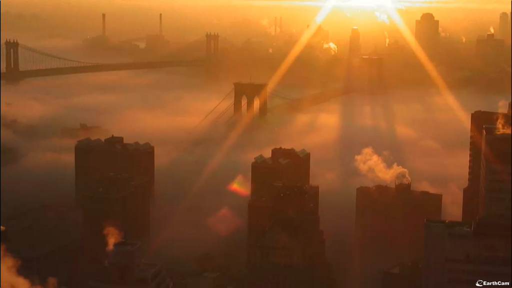 NYC in fog this morning. Image via Earthcam, twitter.