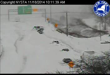Cars buried in lake effect snow, from the New York Thruway camera.