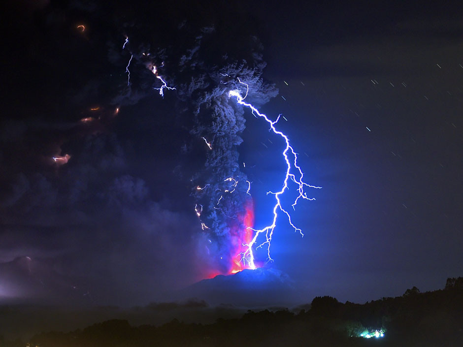 TOPSHOTS View from Frutillar, southern Chile, of lava spewing from the Calbuco volcano, on April 23, 2015. Chile's Calbuco volcano erupted on Wednesday, spewing a giant funnel of ash high into the sky near the southern port city of Puerto Montt and triggering a red alert. Authorities ordered an evacuation for a 10-kilometer (six-mile) radius around the volcano, which is the second in southern Chile to have a substantial eruption since March 3, when the Villarrica volcano emitted a brief but fiery burst of ash and lava. AFP PHOTO/MARTIN BERNETTIMARTIN BERNETTI/AFP/Getty Images