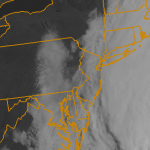 Visible satellite imagery showing a coastal storm system offshore on Tuesday Morning. The storm will graze the area, and move north of New England by Wednesday. Cloudy and damp conditions are likely through Wednesday morning.