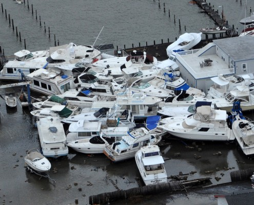 Boats piled on docks from storm surge