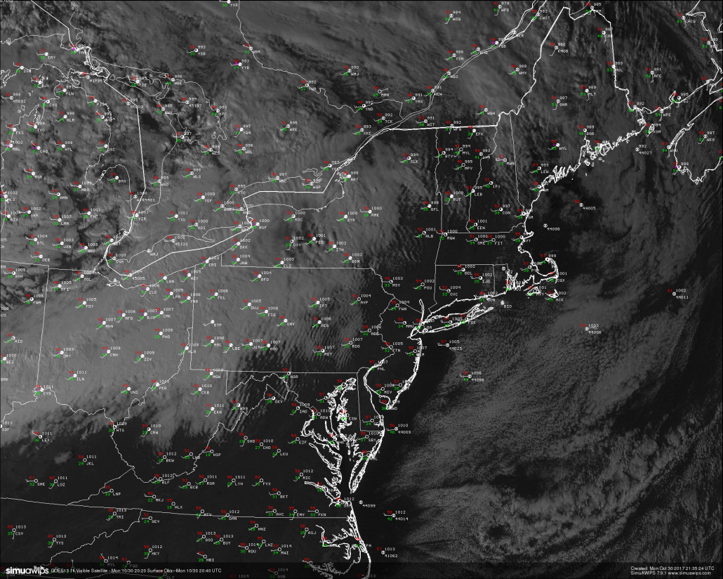 High resolution visible satellite imagery and surface observations over the northeast showing cooling and windy conditions